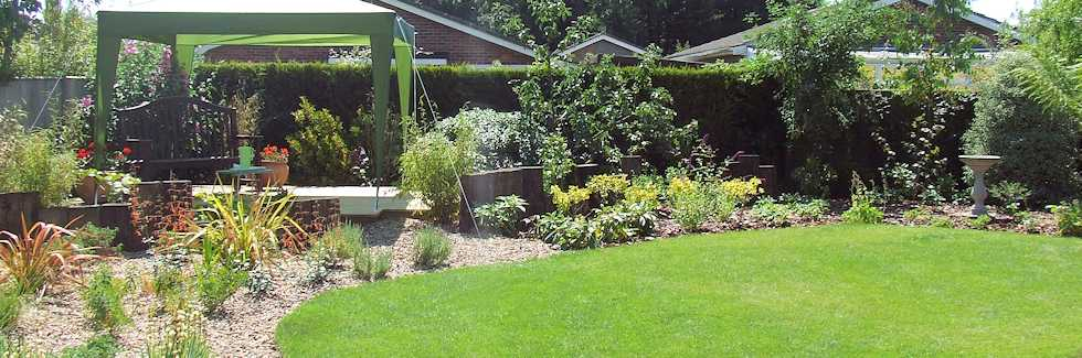 New garden design with turfing, borders, garden features and patio area